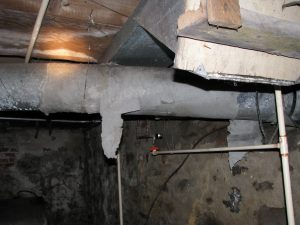 Crumbling asbestos sealant on the forced air system ductwork.