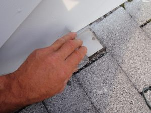 The roofer nailed through the bottom of the step flashing. It's a bad place to put a nail and the result was multiple leaks..